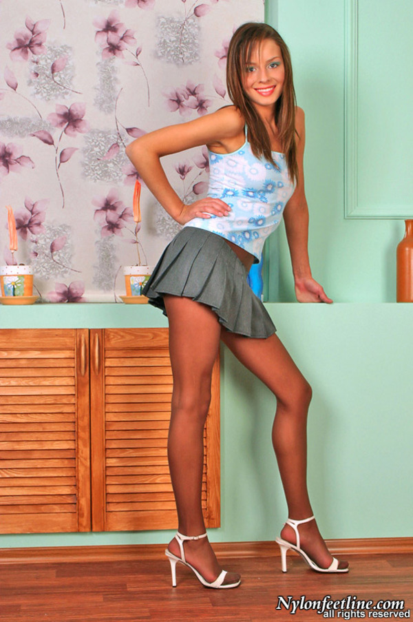 Steamy upskirt chick sniffing and licking her pantyhose